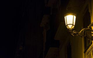 single lamp on dark street