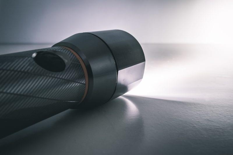 Flashlight shining on a floor.