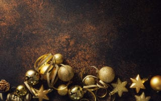 Gold Christmas tree ornaments and strings of gold ribbon.