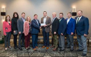 Copesan team presenting a check to the NPMA Pest Management Foundation.