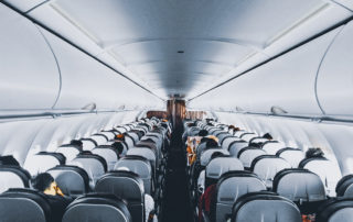 People sitting inside commercial airplane.