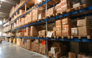 shelves with boxes in stockroom
